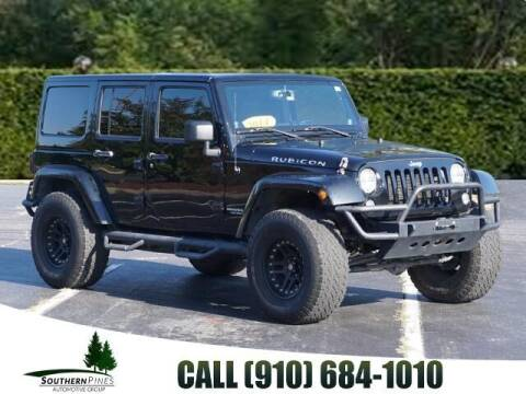 2014 Jeep Wrangler Unlimited for sale at PHIL SMITH AUTOMOTIVE GROUP - Pinehurst Nissan Kia in Southern Pines NC