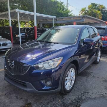 2013 Mazda CX-5 for sale at America Auto Wholesale Inc in Miami FL