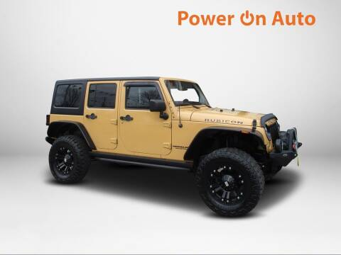 2014 Jeep Wrangler Unlimited for sale at Power On Auto LLC in Monroe NC