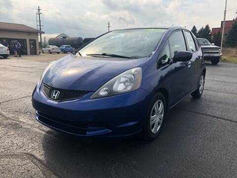 2010 Honda Fit for sale at Mike's Budget Auto Sales in Cadillac MI