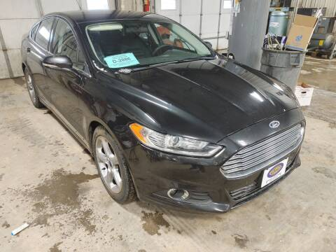 2013 Ford Fusion for sale at BERG AUTO MALL & TRUCKING INC in Beresford SD