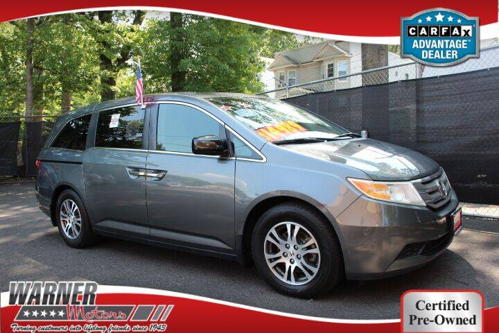 2012 Honda Odyssey for sale at Warner Motors in East Orange NJ