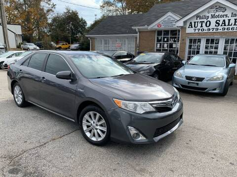 2013 Toyota Camry Hybrid for sale at Philip Motors Inc in Snellville GA