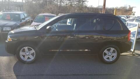 2008 Jeep Compass for sale at Howe's Auto Sales in Lowell MA