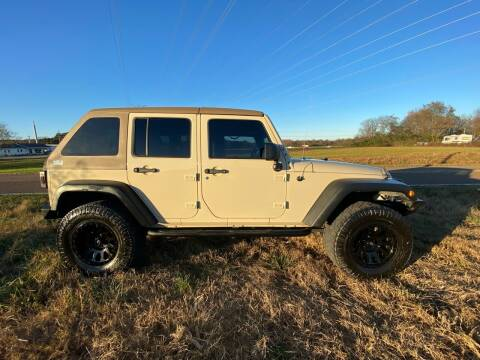 2011 Jeep Wrangler Unlimited for sale at Tennessee Valley Wholesale Autos LLC in Huntsville AL