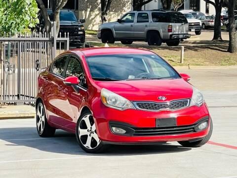 2013 Kia Rio for sale at Texas Drive Auto in Dallas TX