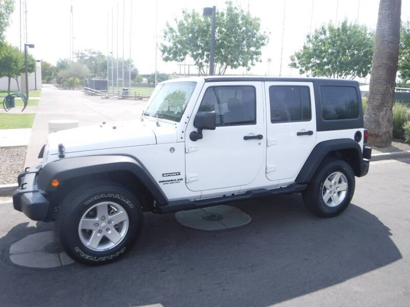 2013 Jeep Wrangler Unlimited for sale at J & E Auto Sales in Phoenix AZ