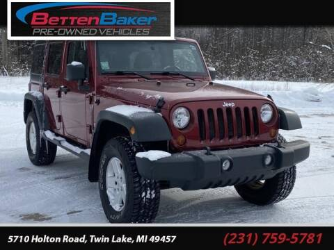 2011 Jeep Wrangler Unlimited for sale at Betten Baker Preowned Center in Twin Lake MI