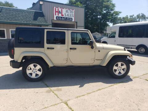 2011 Jeep Wrangler Unlimited for sale at H & L AUTO SALES LLC in Wyoming MI