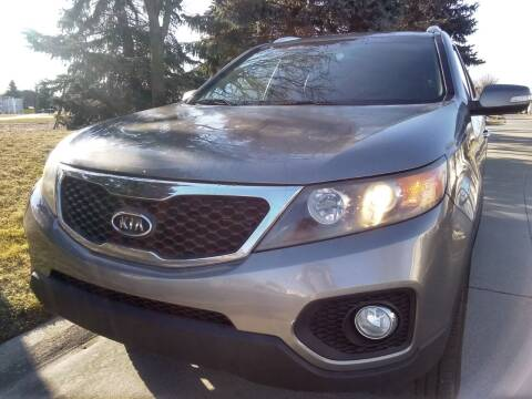 2011 Kia Sorento for sale at Heartbeat Used Cars & Trucks in Harrison Twp MI