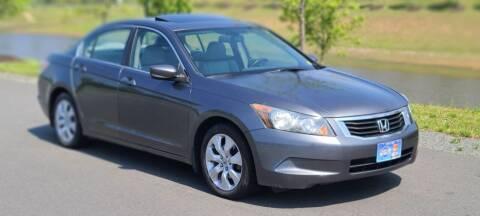 2009 Honda Accord for sale at BOOST MOTORS LLC in Sterling VA