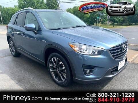 2016 Mazda CX-5 for sale at Phinney's Automotive Center in Clayton NY