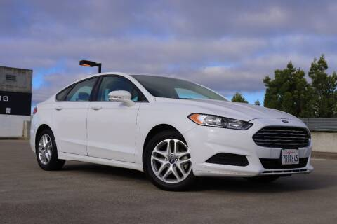 2014 Ford Fusion for sale at La Familia Auto Sales in San Jose CA