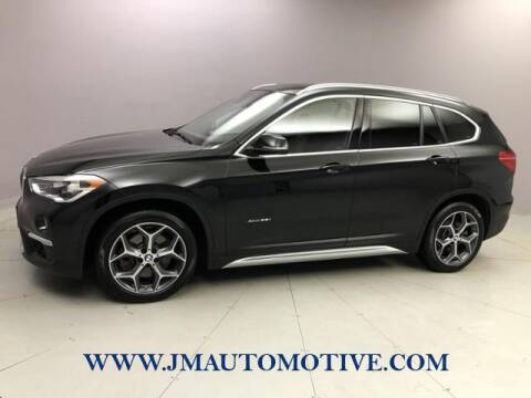 2016 BMW X1 for sale at J & M Automotive in Naugatuck CT
