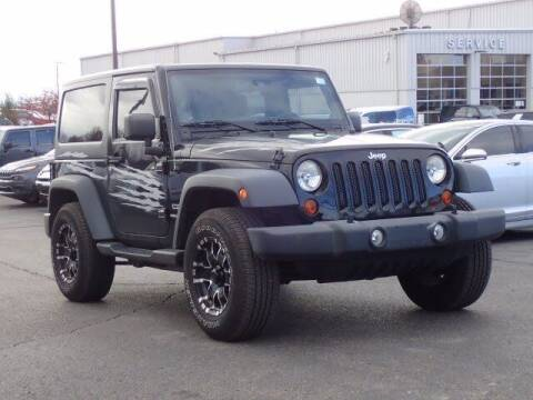 2012 Jeep Wrangler for sale at Szott Ford in Holly MI