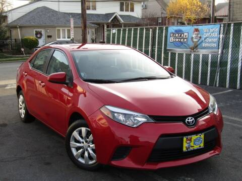 2014 Toyota Corolla for sale at The Auto Network in Lodi NJ