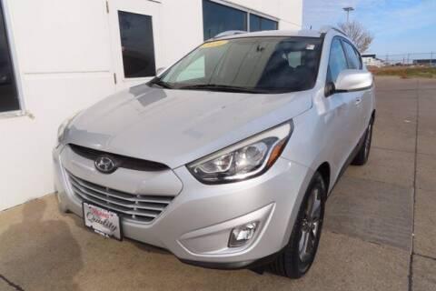 2014 Hyundai Tucson for sale at HILAND TOYOTA in Moline IL