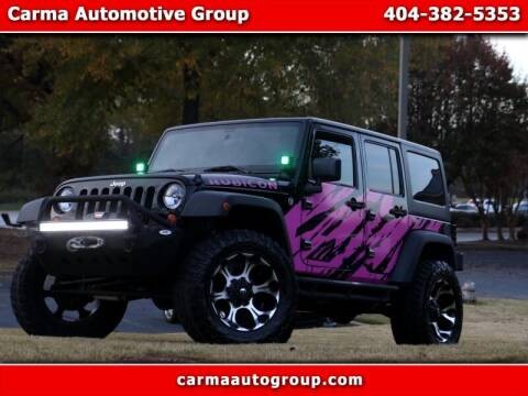 2012 Jeep Wrangler Unlimited for sale at Carma Auto Group in Duluth GA