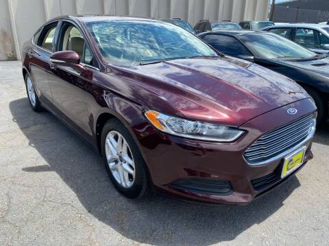 2013 Ford Fusion for sale at New Wave Auto Brokers & Sales in Denver CO