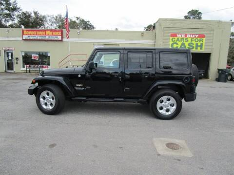 2013 Jeep Wrangler Unlimited for sale at DERIK HARE in Milton FL