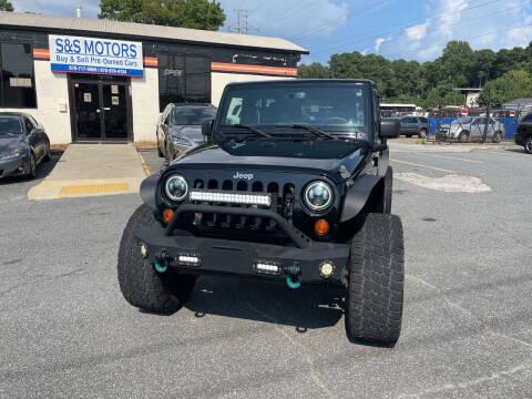 2013 Jeep Wrangler Unlimited for sale at S & S Motors in Marietta GA