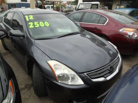 2011 Nissan Altima for sale at SCOTT HARRISON MOTOR CO in Houston TX