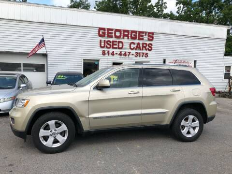 2011 Jeep Grand Cherokee for sale at George's Used Cars Inc in Orbisonia PA