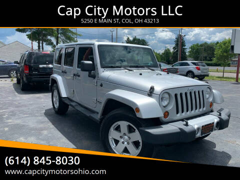 2011 Jeep Wrangler Unlimited for sale at Cap City Motors LLC in Columbus OH