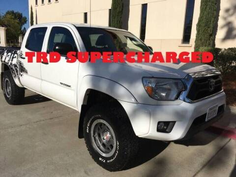 2014 Toyota Tacoma for sale at Auto King in Roseville CA