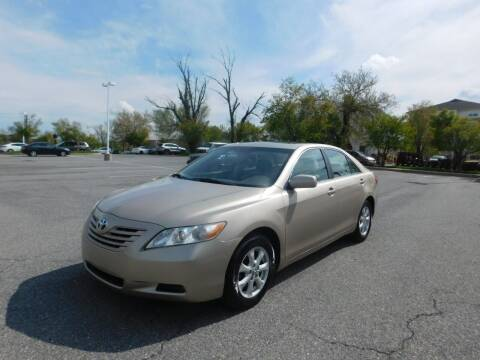 2009 Toyota Camry for sale at AMERICAR INC in Laurel MD