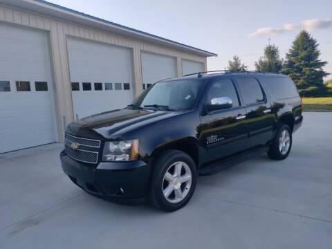 2011 Chevrolet Suburban for sale at Carmart Auto Sales Inc in Schoolcraft MI