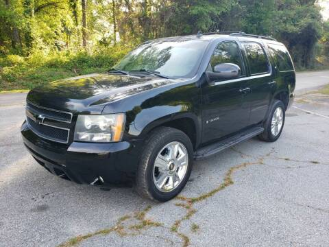 2009 Chevrolet Tahoe for sale at GEORGIA AUTO DEALER, LLC in Buford GA