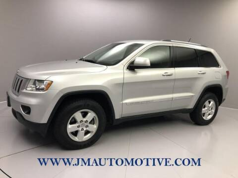 2012 Jeep Grand Cherokee for sale at J & M Automotive in Naugatuck CT