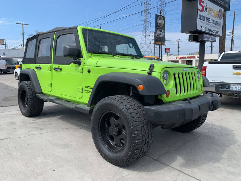 2013 Jeep Wrangler Unlimited for sale at Best Buy Quality Cars in Bellflower CA