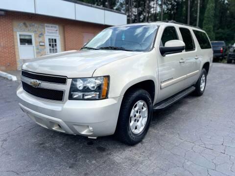 2009 Chevrolet Suburban for sale at Magic Motors Inc. in Snellville GA