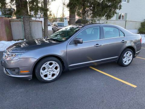 2011 Ford Fusion for sale at AMERI-CAR & TRUCK SALES INC in Haskell NJ