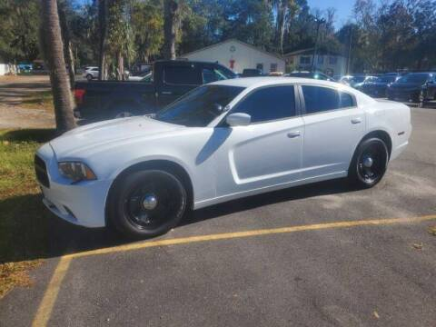 2012 Dodge Charger for sale at REDLINE MOTORGROUP INC in Jacksonville FL