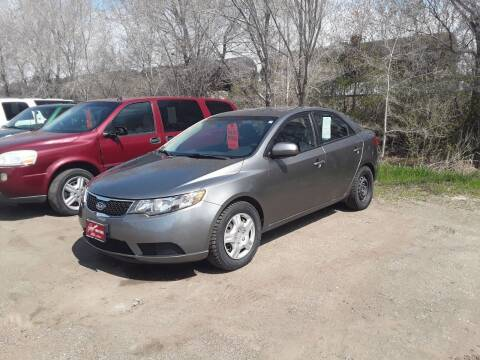 2012 Kia Forte for sale at BARNES AUTO SALES in Mandan ND