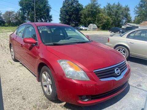 2009 Nissan Altima for sale at HEDGES USED CARS in Carleton MI