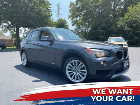 2013 BMW X1 for sale at Woolley Auto Group LLC in Poland OH