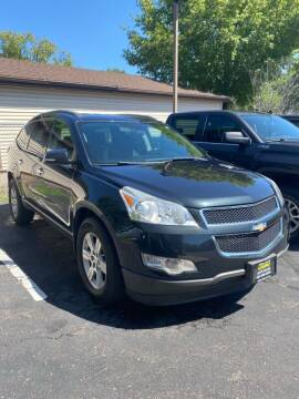 2011 Chevrolet Traverse for sale at Chinos Auto Sales in Crystal MN