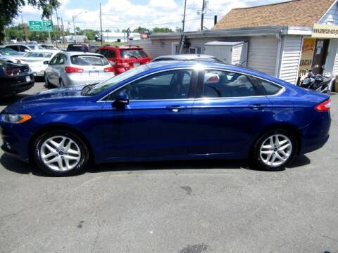 2014 Ford Fusion for sale at American Auto Group Now in Maple Shade NJ