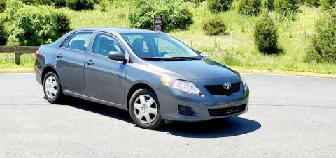 2010 Toyota Corolla for sale at BOOST MOTORS LLC in Sterling VA