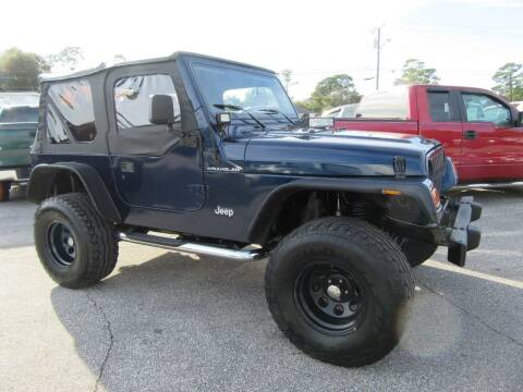 2002 Jeep Wrangler for sale at ARENA AUTO SALES,  INC. in Holly Hill FL