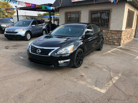 2014 Nissan Altima for sale at Valley Auto Center in Phoenix AZ
