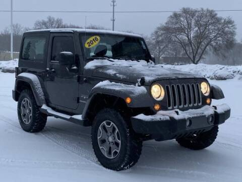 2016 Jeep Wrangler for sale at Betten Baker Preowned Center in Twin Lake MI