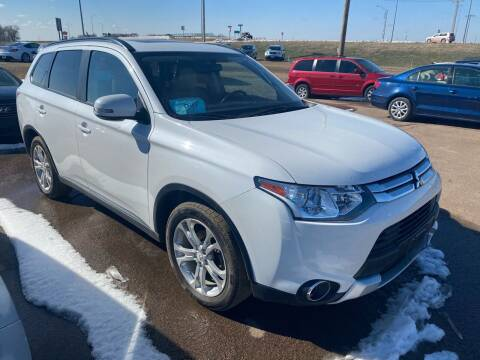 2015 Mitsubishi Outlander for sale at BERG AUTO MALL & TRUCKING INC in Beresford SD