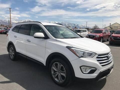 2014 Hyundai Santa Fe for sale at INVICTUS MOTOR COMPANY in West Valley City UT
