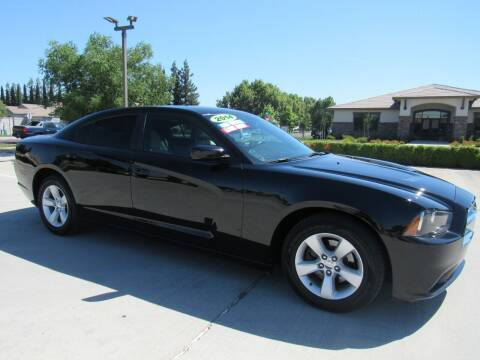 2014 Dodge Charger for sale at Repeat Auto Sales Inc. in Manteca CA