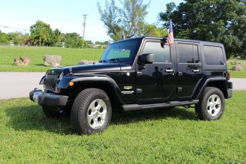 2013 Jeep Wrangler Unlimited for sale at CHASE MOTOR in Miami FL